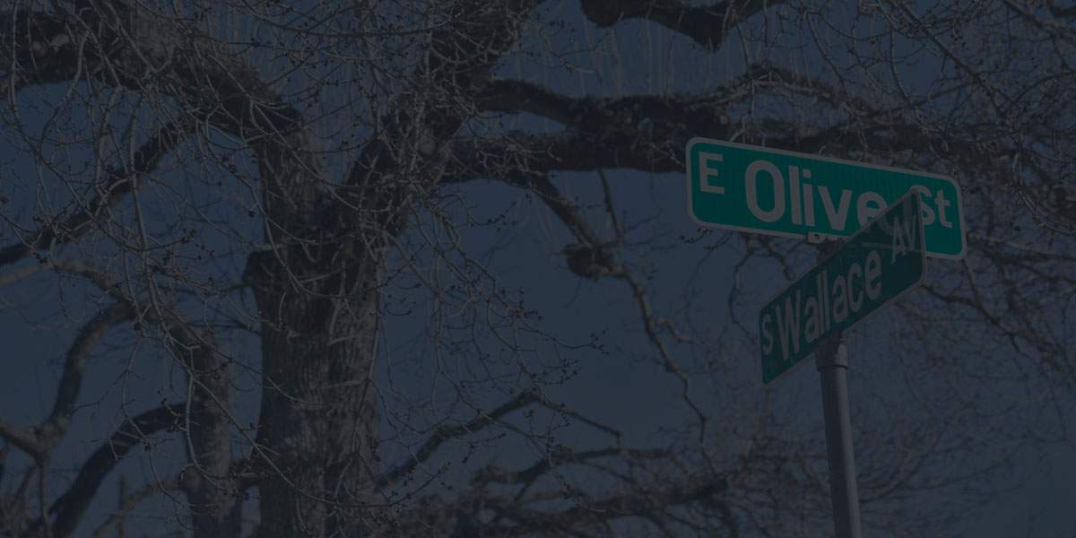 Olive and Wallace street sign intersection in Bozeman, MT is the home of our marketing company