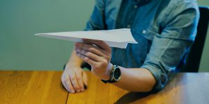 Matt Konen creating a paper airplane in the Big Storm office in Bozeman, MT to illustrate Pay Per Click advertising