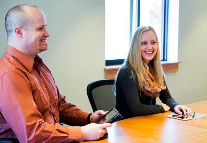 Drew Schug discussing SEO strategy with a client in Bozeman, MT