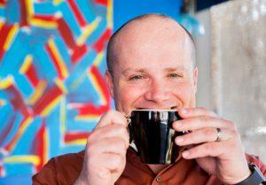 Principal, Drew Schug drinking tea in Bozeman, MT