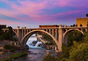 bridge over a river in Spokane, Washington at sunset