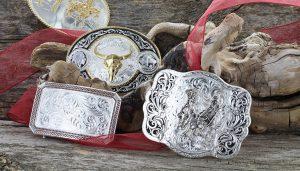 Montana Silversmiths buckles displayed on wood