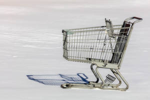 abandoned shopping cart in snow