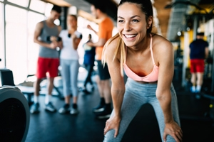 woman in gym smiling