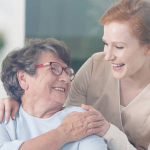woman smiling up at her nurse