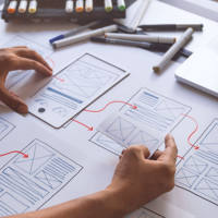 person wireframing a website
